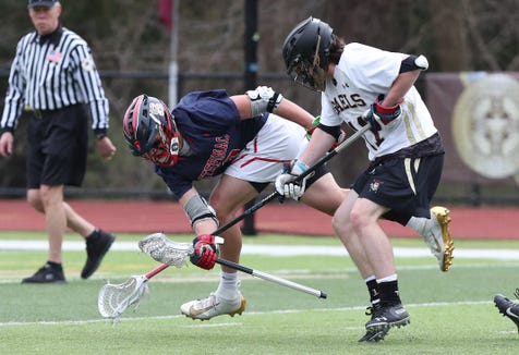 Iona's Jack O'Byrne (11) puts pressure on Stepinac's Joey Carino (3) during lacrosse action at Iona Prep in New Rochelle April 11,  2019. Iona won the game 10-6.