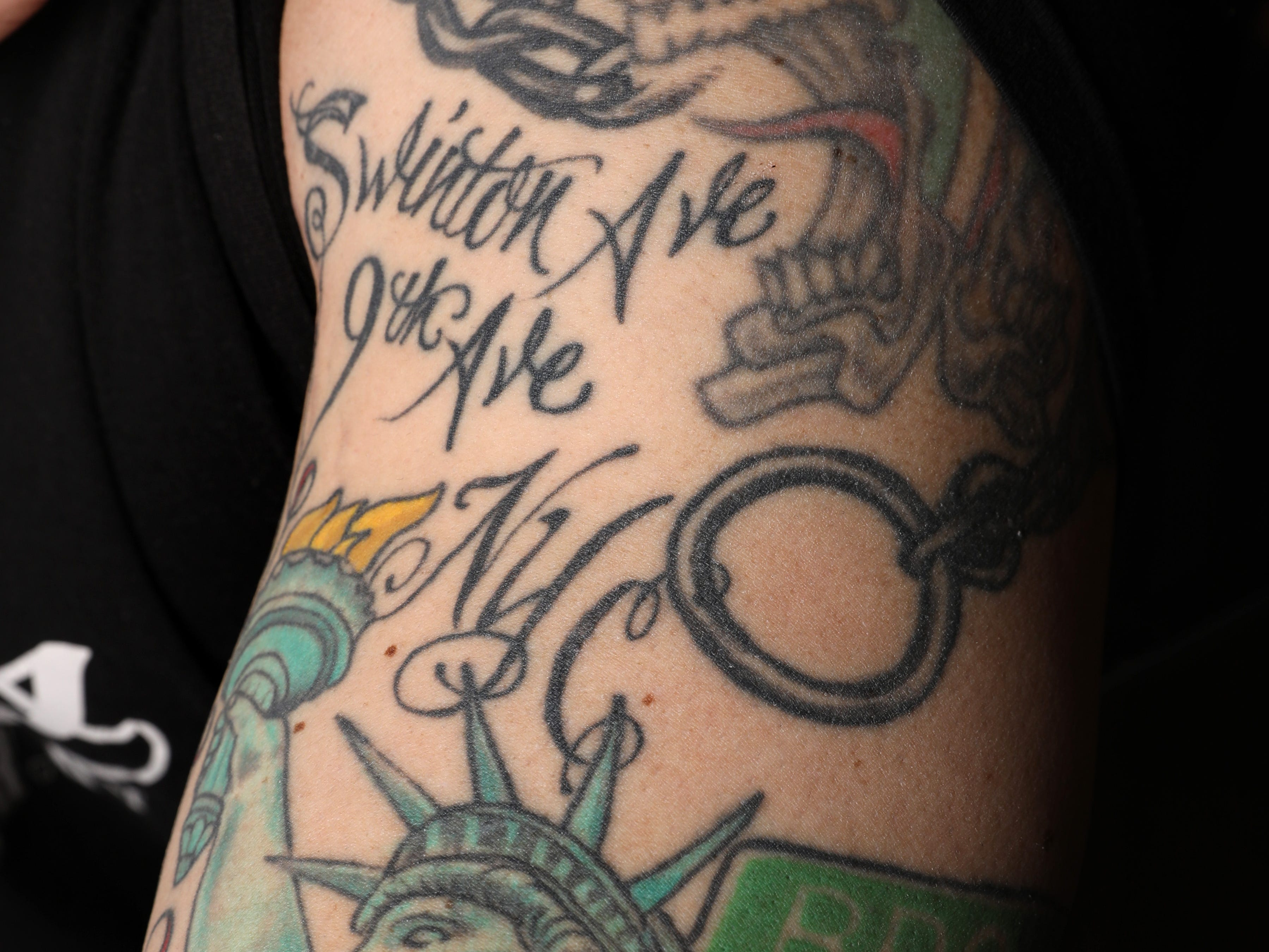 Chef Michael Russo, owner of Russo's in Pearl River, shows his tattoo dedicated to his parents' New York City roots, March 19, 2019. Russo finds that his tattoos tell stories about himself without saying a word.