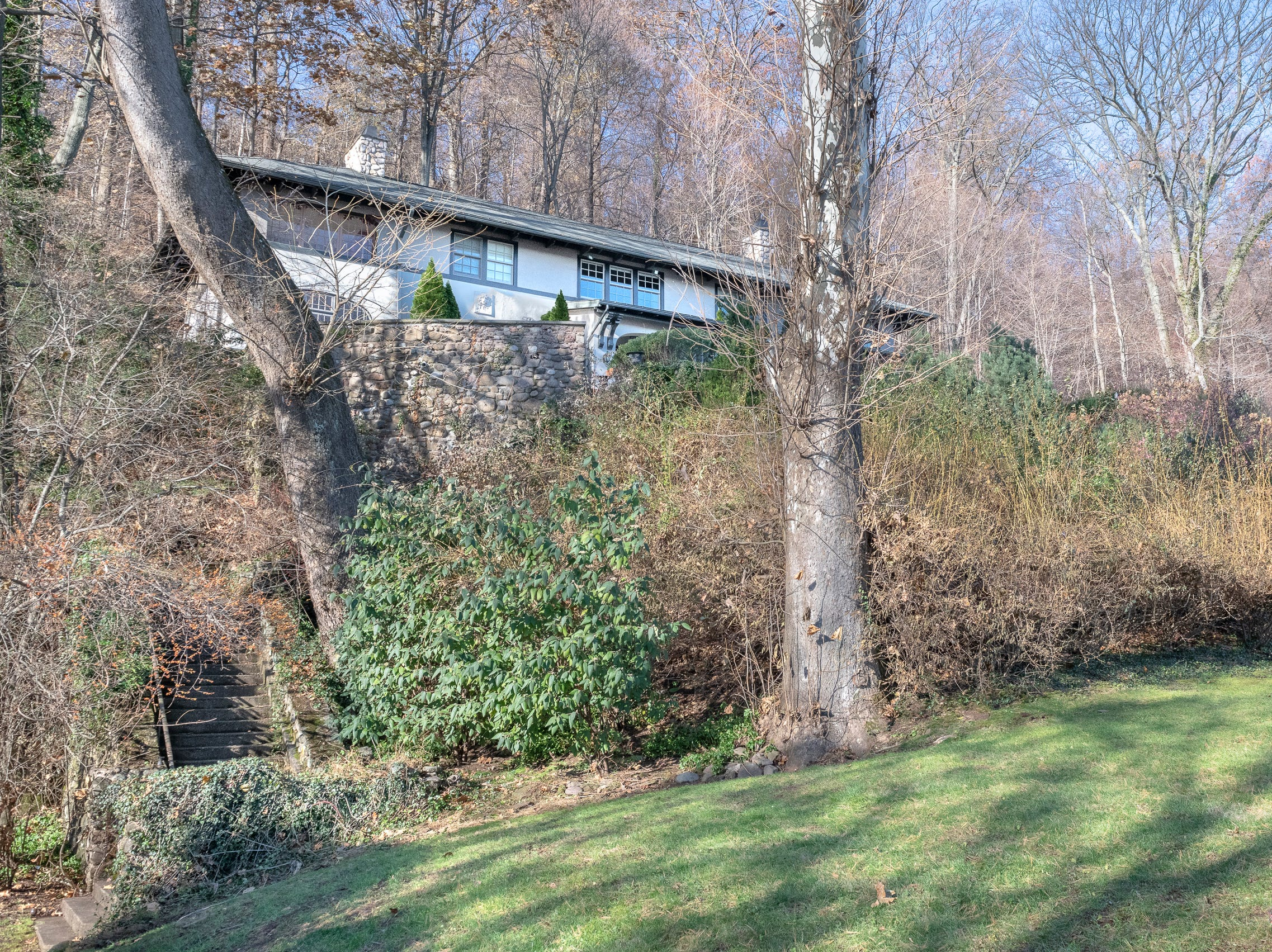 The home sits high up on River Road affording views of the Hudson River and lots of privacy.