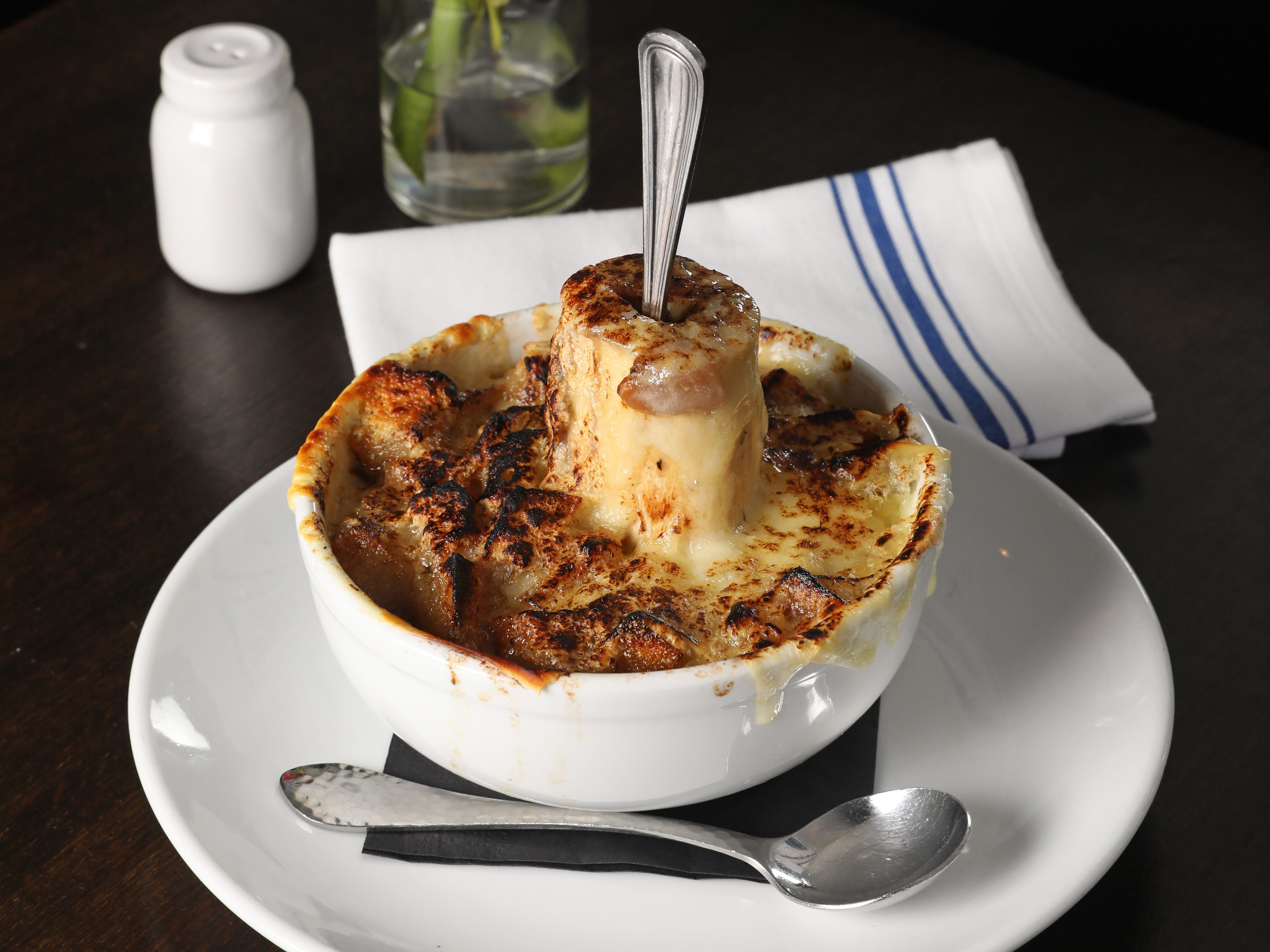 French onion soup with marrow bone by chef Matthew Safarowic at The Whitlock in Katonah March 14, 2019.