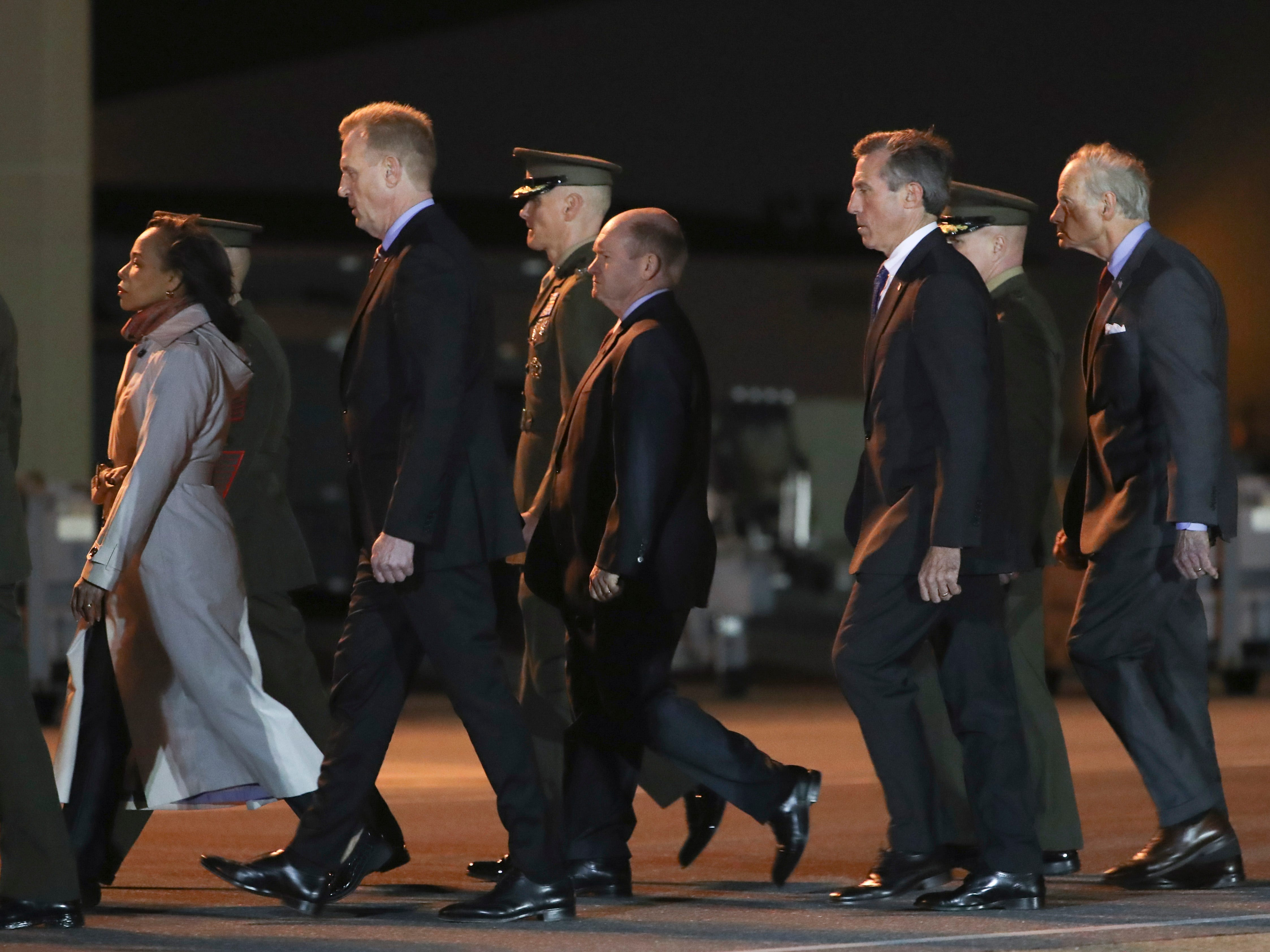 Delaware elected officials and military officials including (from left) Rep. Lisa Blunt Rochester, Acting Secretary of Defense Patrick Shanahan, Senator Chris Coons, Gov. John Carney and Sen. Tom Carper leave the tarmac after the remains of Marine Staff Sgt. Christopher A. Slutman were transferred from a plane to the mortuary at Dover Air Force Base in a solemn process Thursday evening.