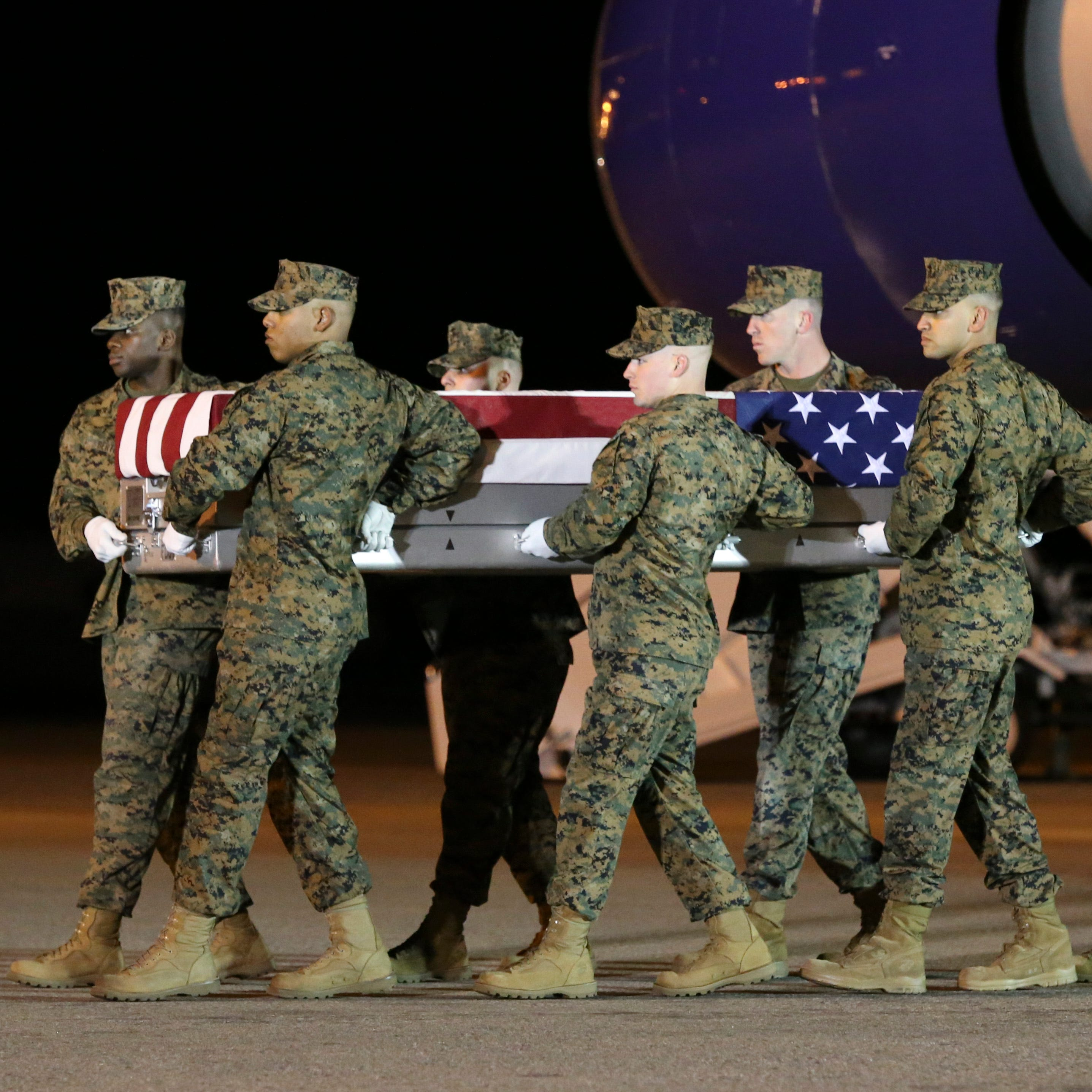 Remains of Delaware Marine Christopher Slutman arrive at Dover Air Force Base