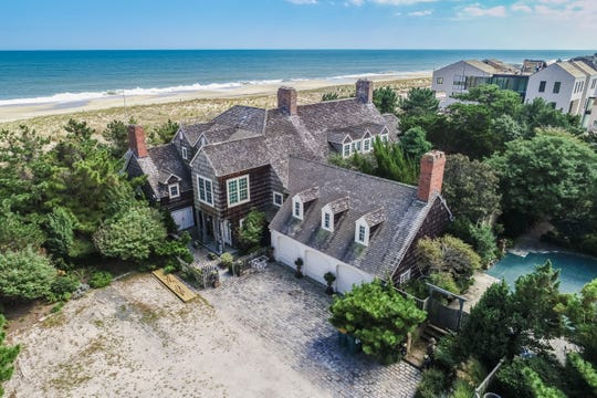 This $14.9 million Rehoboth Beach House was built in 1920 and is on both the ocean and Silver Lake.