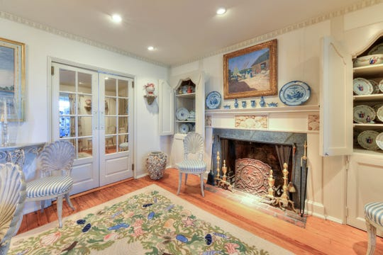The dining room features an original mantelpiece decorate with seashells.