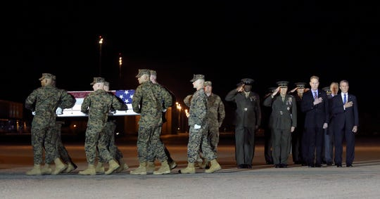 Military officials including (from left) Air Force Col. Matthew Jones, Sgt. Major of the Marine Corps Ronald Green, Marine Corps Commandant General Robert Neller and Acting Secretary of Defense Patrick Shanahan and Gov. John Carney salute during the transfer of remains of Marine Staff Sgt. Christopher A. Slutman at Dover Air Force Base Thursday evening.