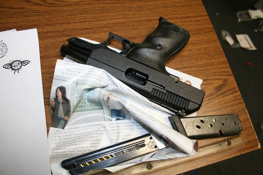 A handgun and ammunition recovered inside Marinette High School after the hostage taking incident on November 29, 2010. Provided by Marinette Police Department