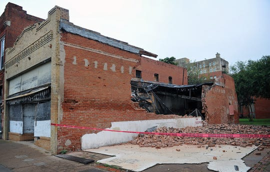 In this file photo, a side brick wall of 615 7th Street collapsed overnight in August 2017. The structure has housed numerous businesses over the years and is one of the oldest in downtown Wichita Falls. What remains of the building is up for demolition by the city because it is deemed dangerous.