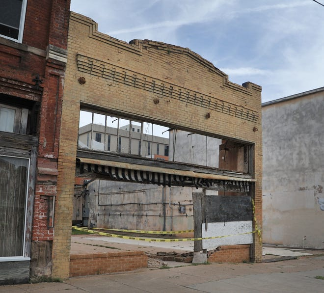 A downtown building constructed in the 1890s, now nearly just a front and back wall may be restored to its former glory with approval from the Landmark Commission. The group met Tuesday to discuss design for a major construction overhaul of the property by Syd Litteken architects.