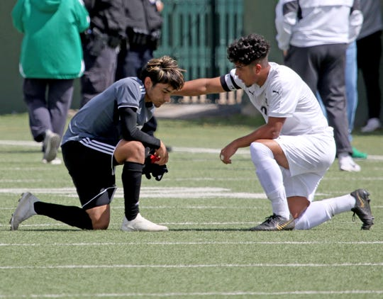 Lake Dallas' Julian Fernandez talks with Wichita Falls High School's Maro Barron after the Falcons 4-2 win over the Coyotes Friday, April 12, 2019, at Memorial Stadium in the Region I-5A Tournament.