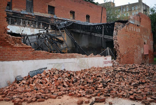The west exterior wall of a building at 615 7th Street has become a possible health and safety hazard. The building has housed a variety of businesses since it was constructed in 1906, including a domino parlor in the 1930s and a clothing store in the 1960s.
