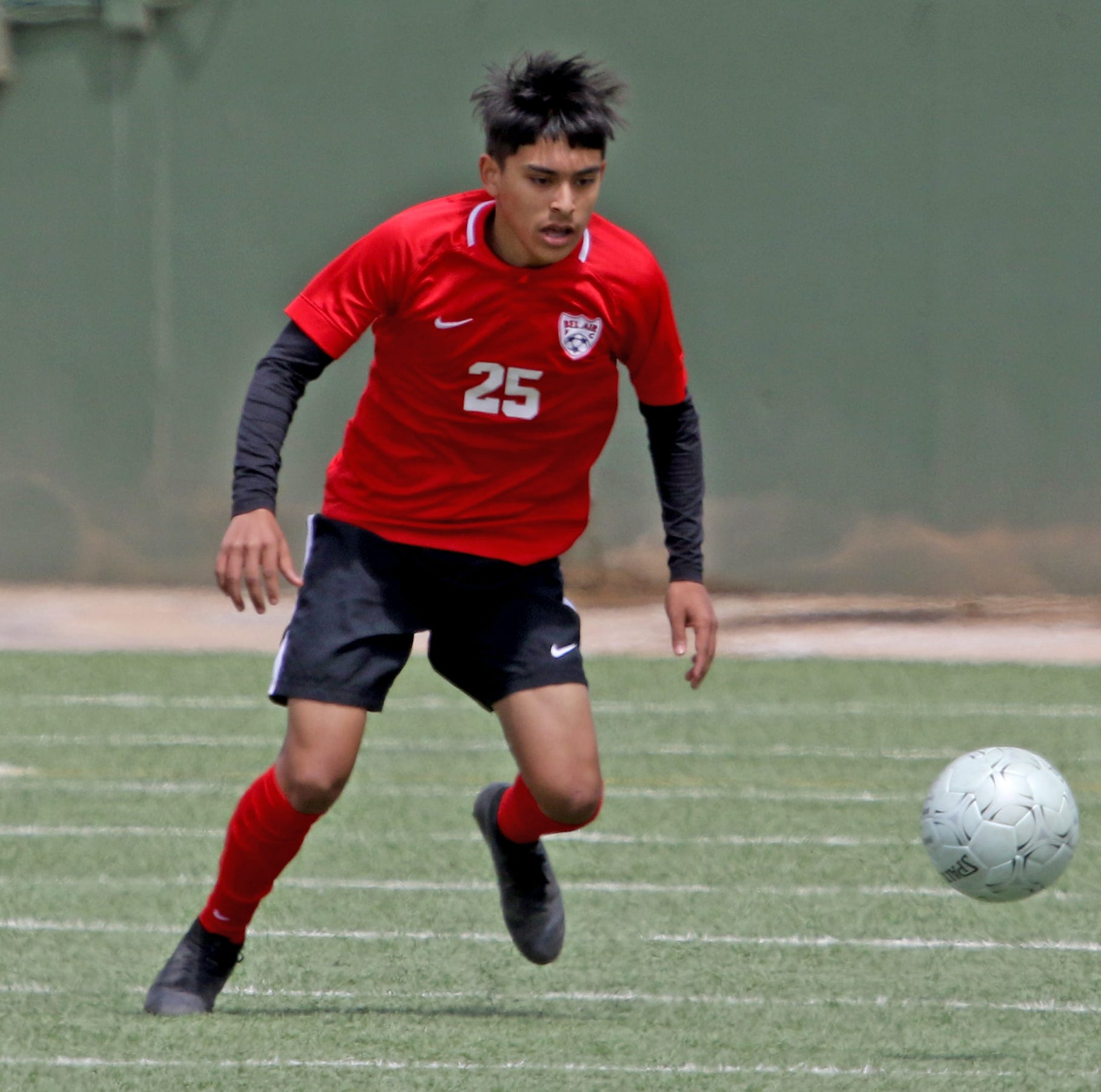 Bel Air's Cedric Carbajal moves to the ball in the Region I-5A Tournament against Burleson Friday, April 12, 2019, at Memorial Stadium in Wichita Falls.