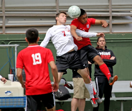 Burleson's Caleb Yauger, left, and Bel Air's Jose Gurrola go for the ball in the  Region I-5A Tournament Friday, April 12, 2019, at Memorial Stadium in Wichita Falls.