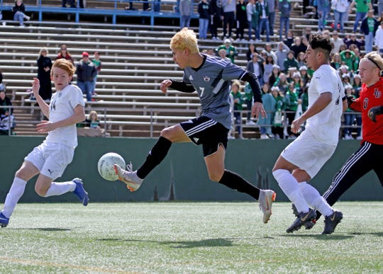 Wichita Falls High School's Daniel Alvarez scores a goal against Lake Dallas Friday, April 12, 2019, at Memorial Stadium in the Region I-5A Tournament. The Falcons defeated the Coyotes 4-2.
