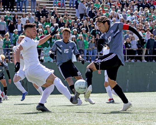 Lake Dallas' Jose Rodriguez and Wichita Falls High School's Marco Barron reach the ball at the same time Friday, April 12, 2019, at Memorial Stadium in the Region I-5A Tournament. The Falcons defeated the Coyotes 4-2.
