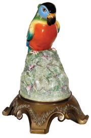 This rare bird, a ceramic parrot, conceals the working parts of a radio loudspeaker made in 1927. It substituted for the large horn used to amplify the sound of the radio and sold for about $900.