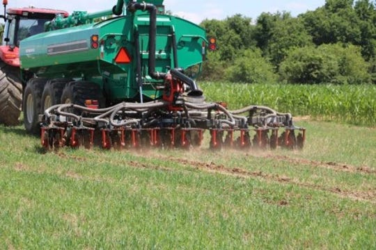Liquid manure being injected into a field.