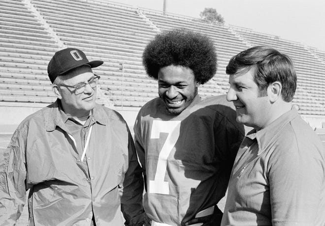 Ohio State coach Woody Hayes (left) talks with his quarterback Cornelius Green, who was voted the most valuable player in the 1974 Rose Bowl. Greene completed 6 of 8 passes for 129 yards and ran for a touchdown in the Buckeyes 42-21 beating of defending national champion USC. (AP Photo Archive)