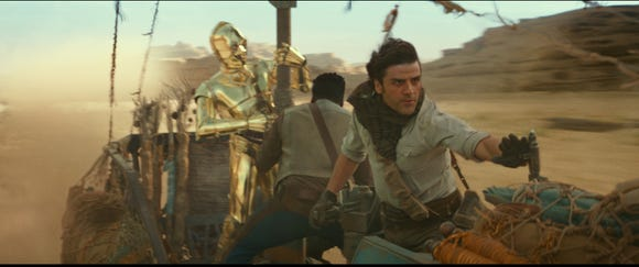 "C-3PO (Anthony Daniels, far left), Finn (John Boyega) and Poe Dameron (Oscar Isaac) find themselves in a sticky situation in ""Star Wars: The Rise of Skywalker."""