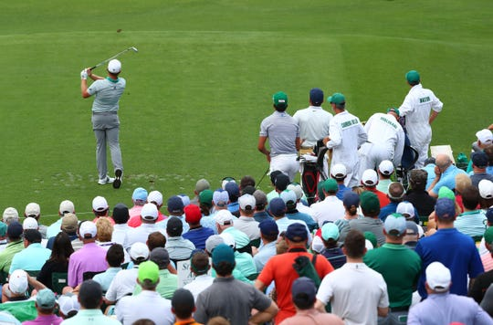Fans get a close up view of Tyrrell Hatton at the tee box on No. 12.