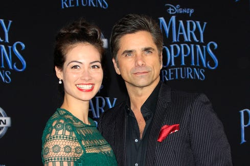 """John Stamos and his wife, Caitlin McHugh, arrive for the Hollywood premiere of Disney's """"Mary Poppins Returns."""""""