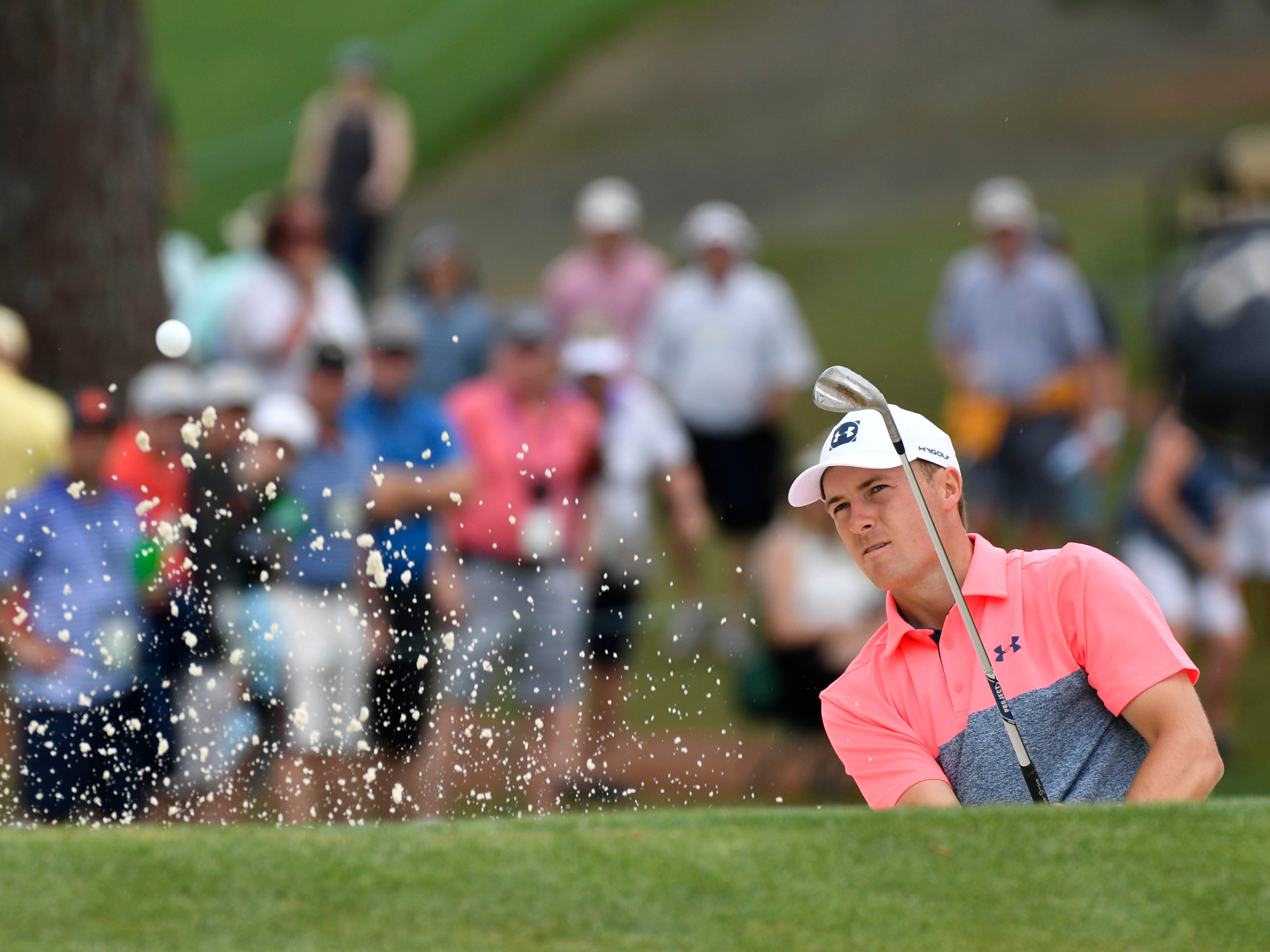 Jordan Spieth hits out of a bunker on the seventh hole during the second round of the Masters.