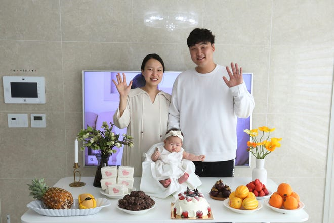 Lee Dong Kil and his wife Ryu Da Gyeong pose with their daughter Lee Yoon Seol. Just two hours after Lee's daughter was born on New Year's Eve, the clock struck midnight, 2019 was ushered in, and the infant became 2-years-old. She wasn't alone, though it happened for her quicker than most: Every baby born in South Korea last year became 2 on Jan
