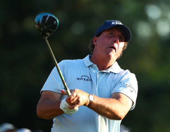 Phil Mickelson, teeing off on the 18th hole, heads into the second round of the Masters in third place. (Photo: Rob Schumacher, USA TODAY Sports)