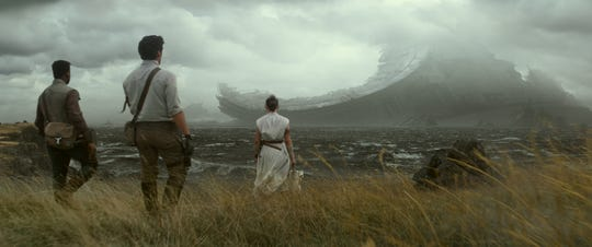 "Finn (John Boyega, far left), Poe Dameron (Oscar Isaac) and Rey (Daisy Ridley) find what looks to be wreckage from a Death Star in ""Star Wars: The Rise of Skywalker."""