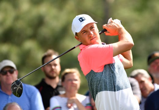Jordan Spieth hits his tee shot on the 18th hole during the second round of the Masters.