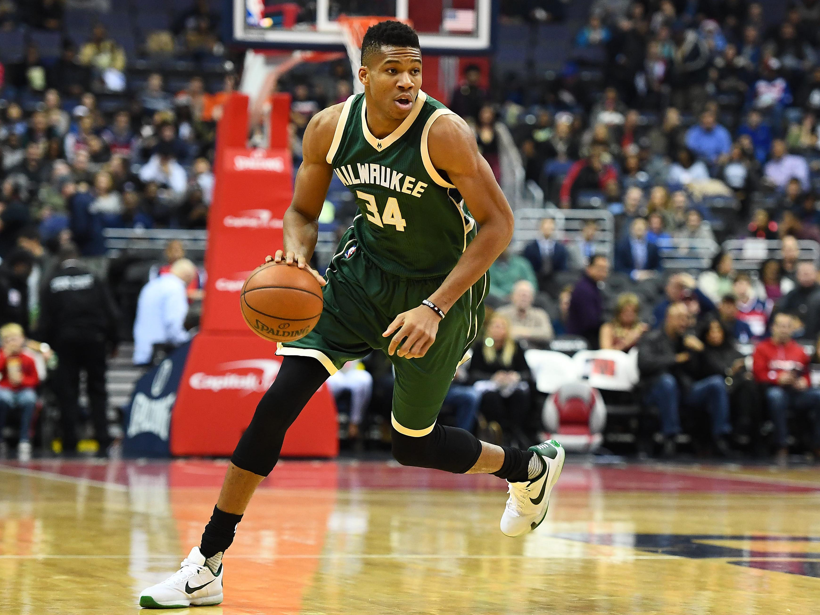 Antetokounmpo dribbles up the court during a 2016 game against Washington.