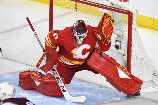 Calgary Flames goalie Mike Smith makes a save against the Colorado Avalanche in Game 1 of their first-round NHL playoff series.