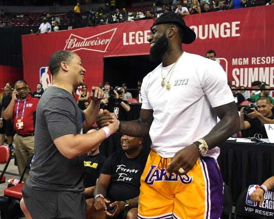 Tyronn Lue greets LeBron James after a Summer League game.