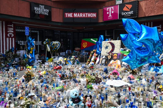 Hundreds of candles sit in front of The Marathon Store on the corner of Crenshaw and Slauson on April 11, 2019.