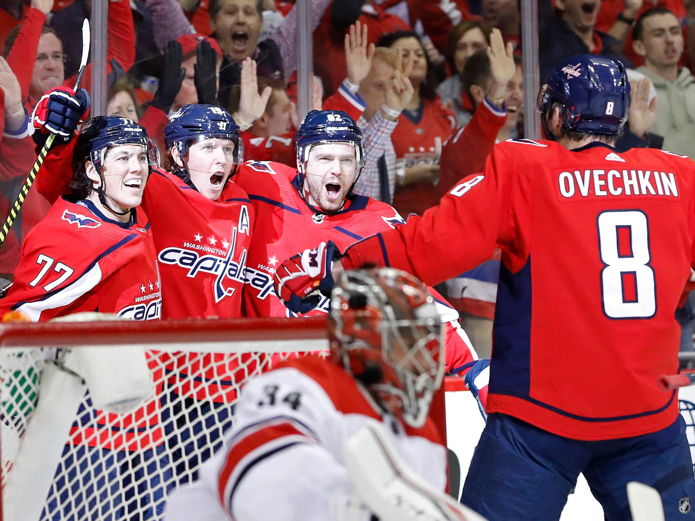 First round: Washington Capitals center Nicklas Backstrom (center) celebrates with teammates after scoring a goal against the Carolina Hurricanes in the first period in Game 1 at Capital One Arena. The Capitals won, 4-2.