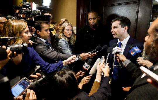 Mayor Pete Buttigieg of South Bend, Indiana, talks with reporters after addressing the National Action Network's annual national convention in New York City on April 4, 2019.