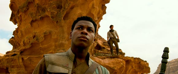 "Finn (John Boyega, left) and Poe Dameron (Oscar Isaac) go on a mission in ""Star Wars: The Rise of Skywalker."""