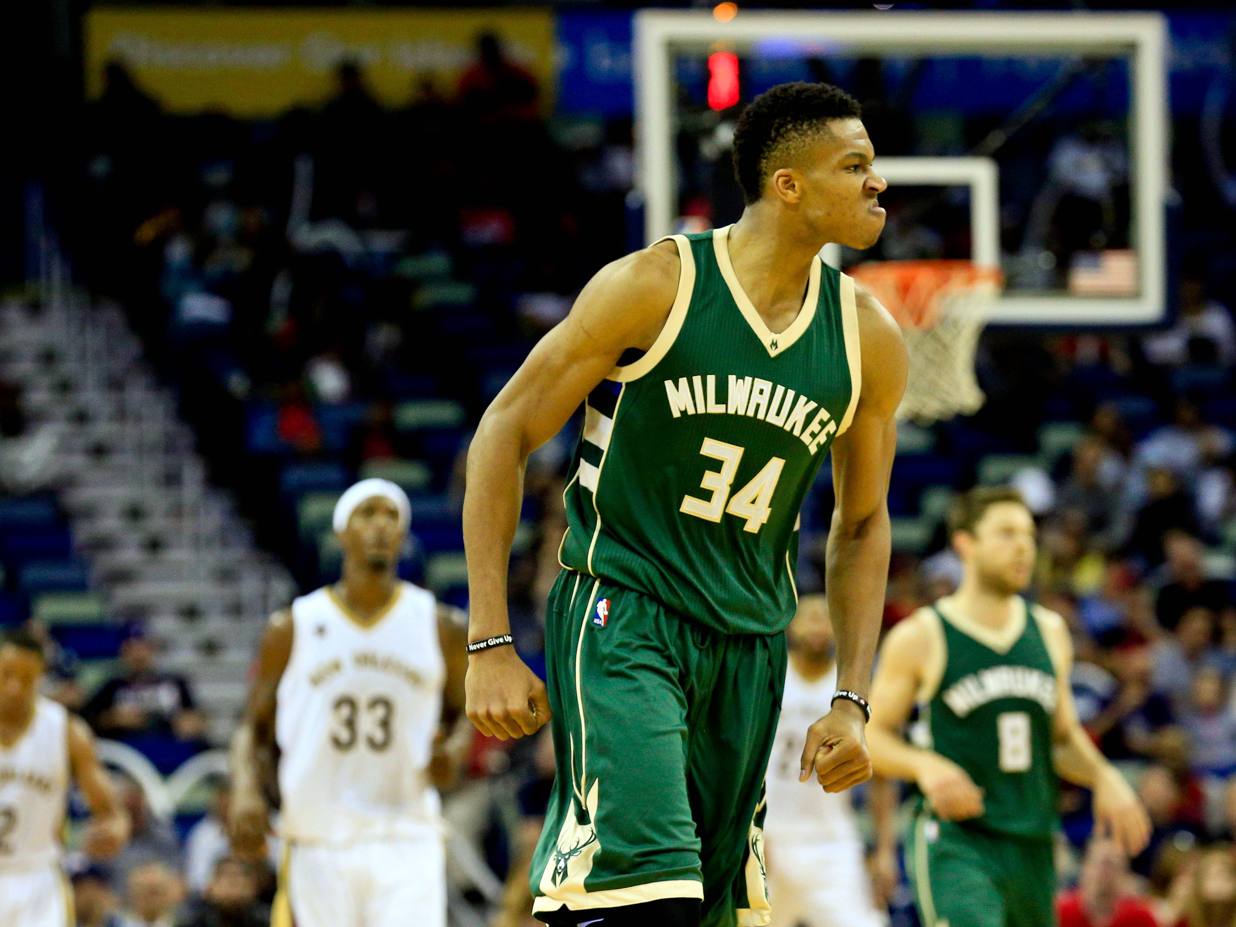 Antetokounmpo flexes after a basket during a 2016 game against New Orleans.