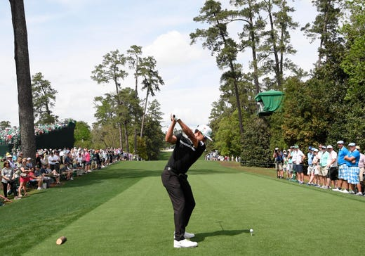 Rafael Cabrera Bello hits his tee shot on the 18th hole during the second round of the Masters.