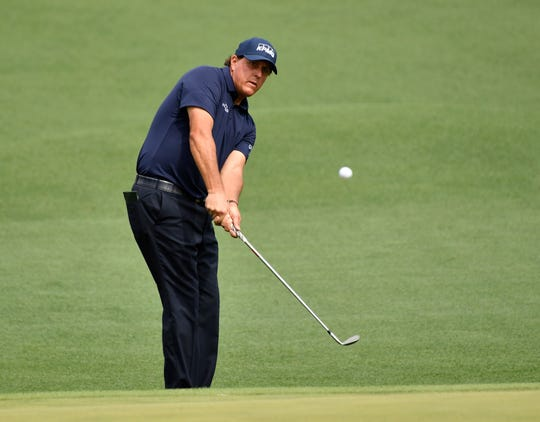 Phil Mickelson chips onto the green during the second round of the Masters.