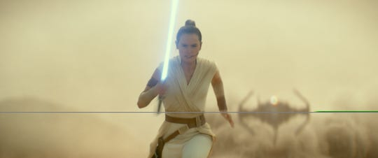 "Rey (Daisy Ridley) is on the run from Kylo Ren's TIE Fighter in ""Star Wars: The Rise of Skywalker."""