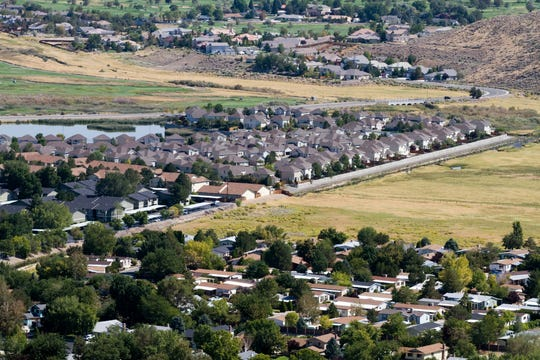 Aerial view of suburban neighborhoods as developments sprawl out into surrounding open areas in Reno, Nevada, USA.