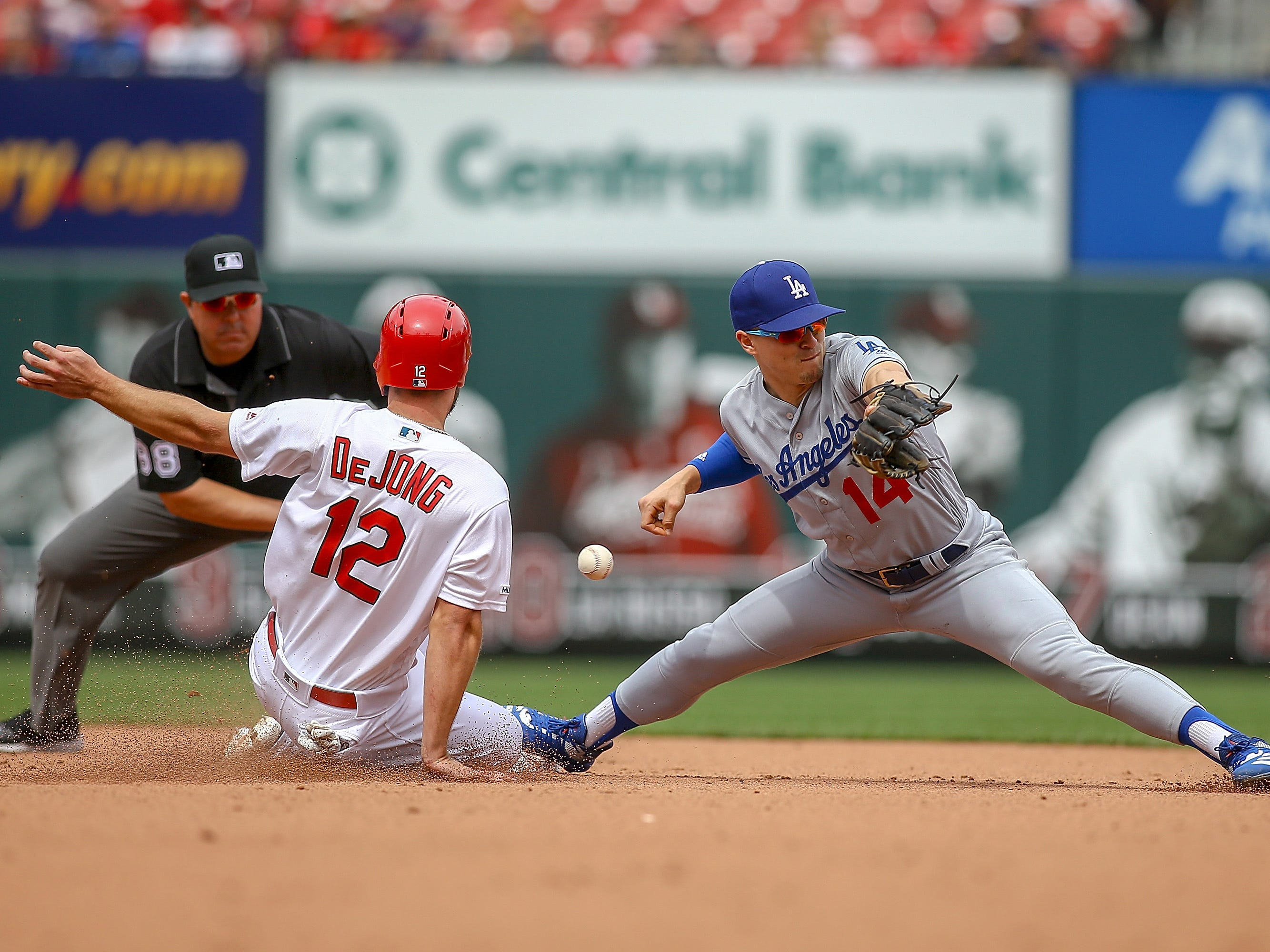 April 11: The  St. Louis Cardinals' Paul DeJong steals second against the Los Angeles Dodgers as Enrique Hernandez tries to corral the throw during the fifth inning at Busch Stadium. The Cardinals won the game, 11-7.
