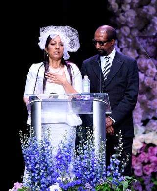Angelique Smith and Dawit Asghedom, right, speak onstage during the Celebration of Life memorial service for their late son, Nipsey Hussle, at the Staples Center.