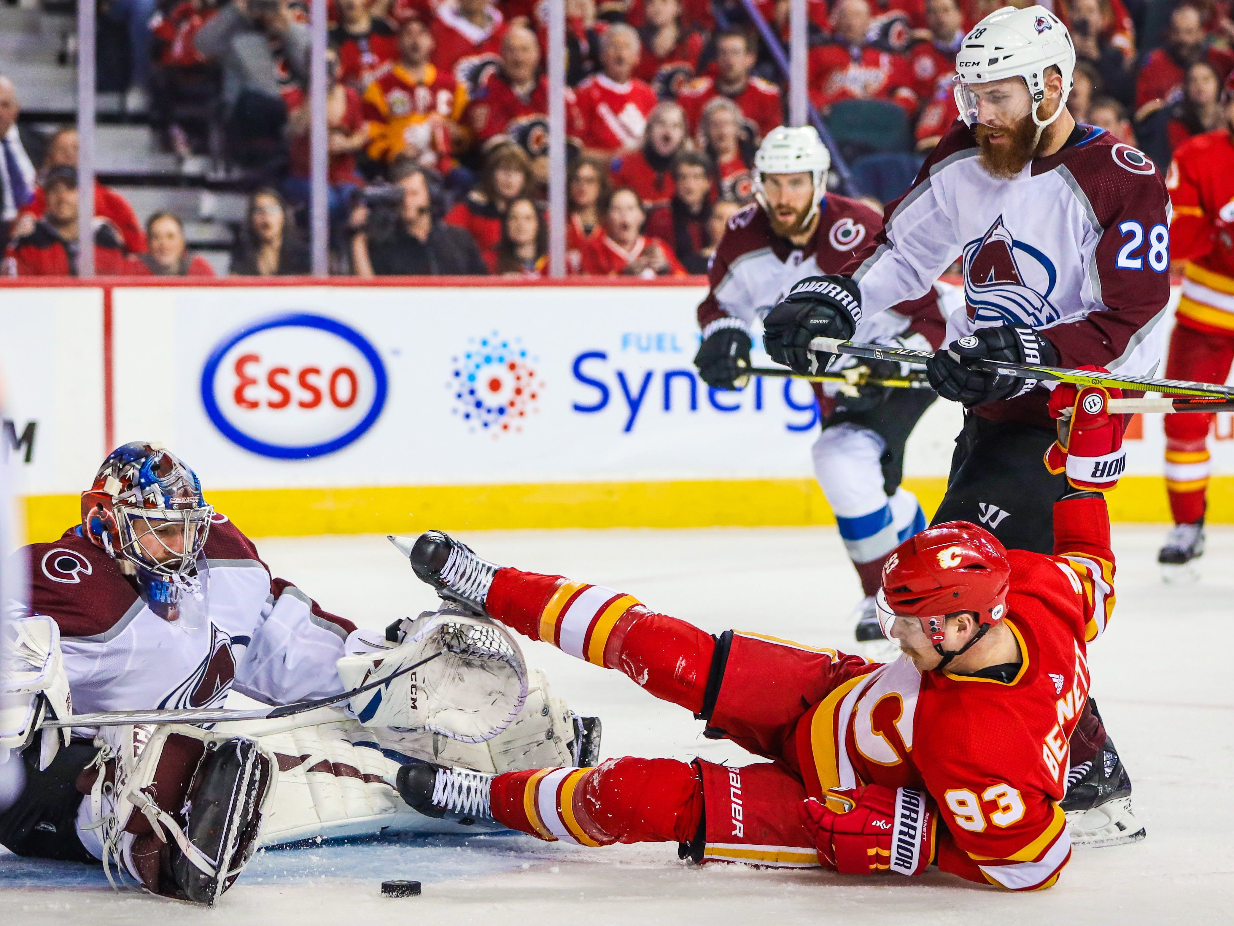 First round: Colorado Avalanche goaltender Philipp Grubauer makes a save against Calgary Flames center Sam Bennett (93) during the second period in Game 1 at Scotiabank Saddledome. The Flames won the game, 4-0.
