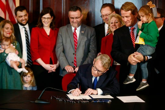 Gov. Mike DeWine speaks before signing a bill imposing one of the nation's toughest abortion restrictions, April 11, 2019 in Columbus, Ohio.