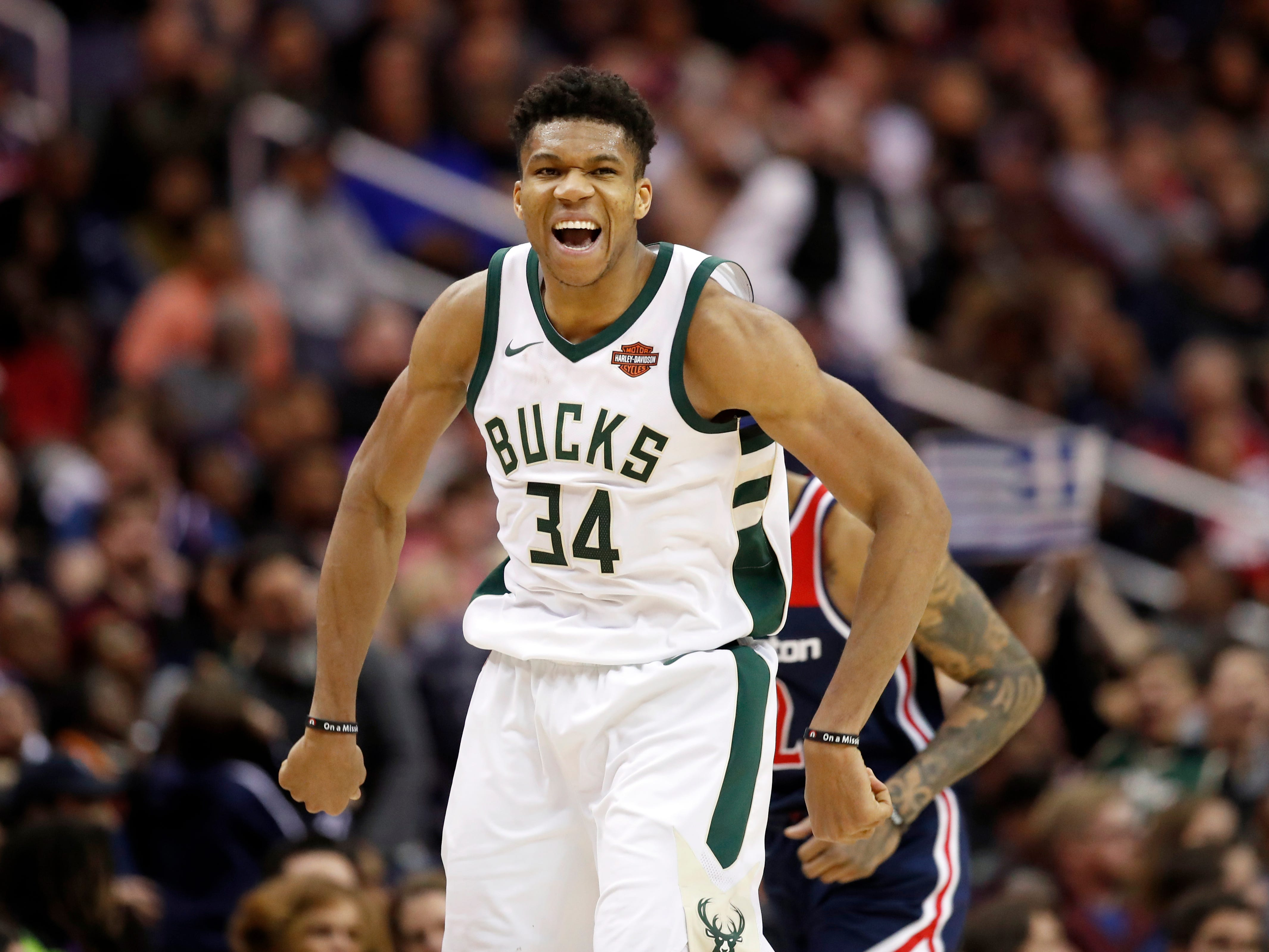 Antetokounmpo celebrates after making a shot during a 2018 game against Washington.