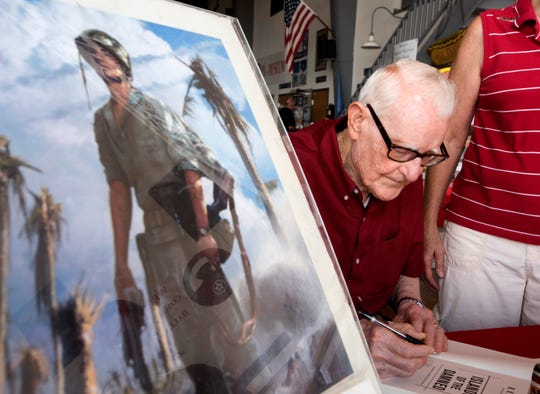 """Burgin signed copies of his book, """"Islands of the Damned: A Marine at War in the Pacific"""" in Texas in 2015."""