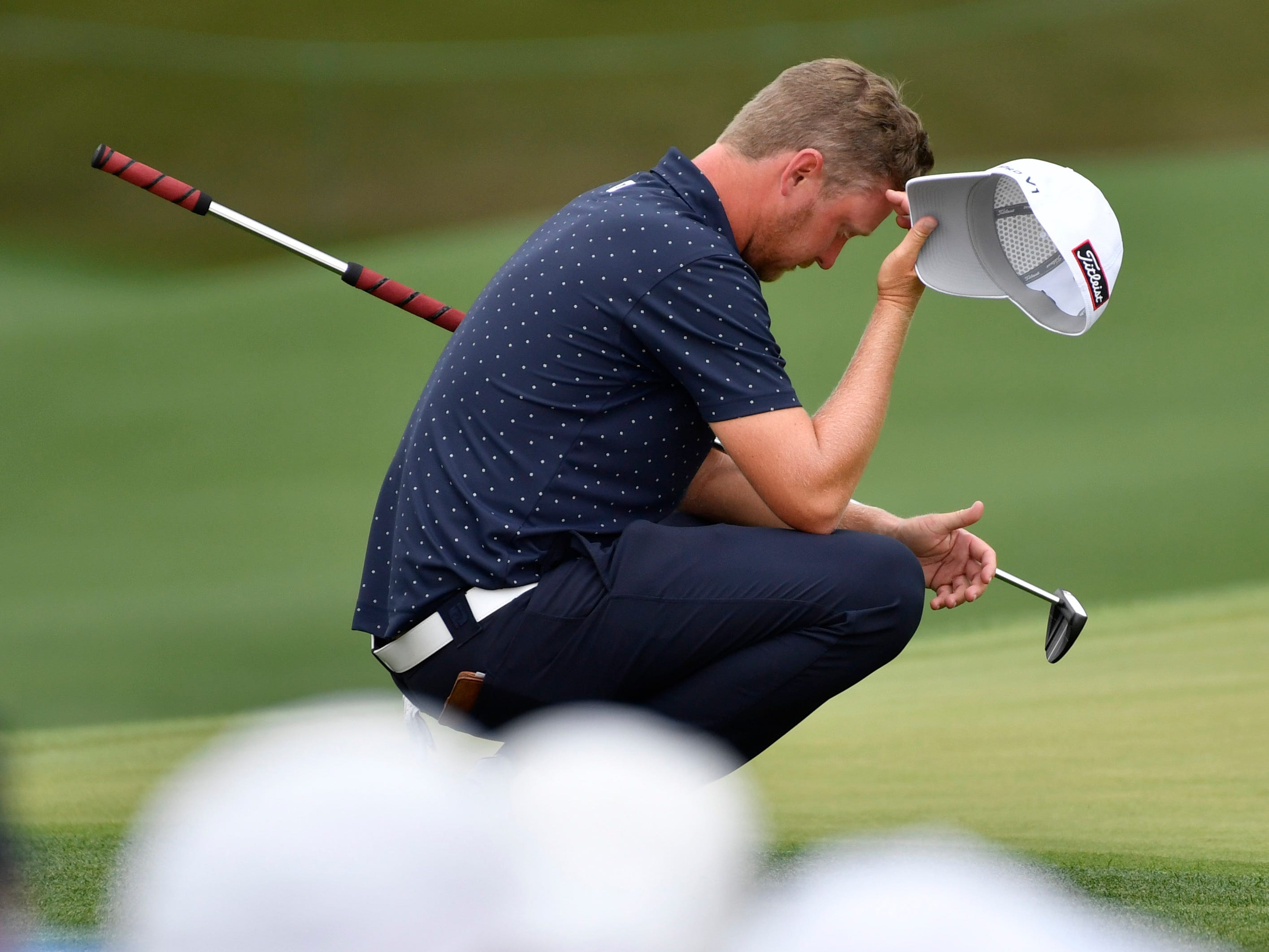 Justin Harding reacts after putting on the 18th green during the second round of the Masters.