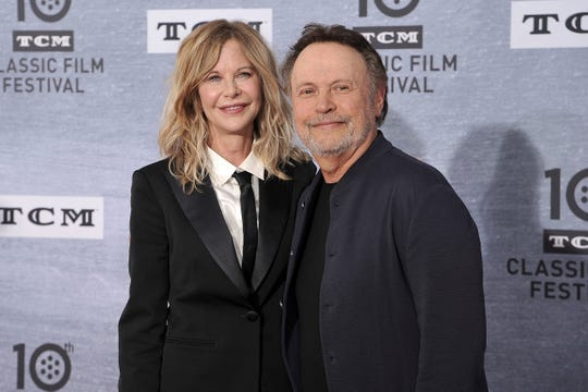 "Meg Ryan, left, and Billy Crystal attend the 2019 TCM Classic Film Festival opening night gala ""When Harry Met Sally."""