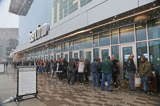 Giannis Antetokounmpo fans line up early before the final regular-season game in hopes of getting a bobblehead of the NBA MVP hopeful.
